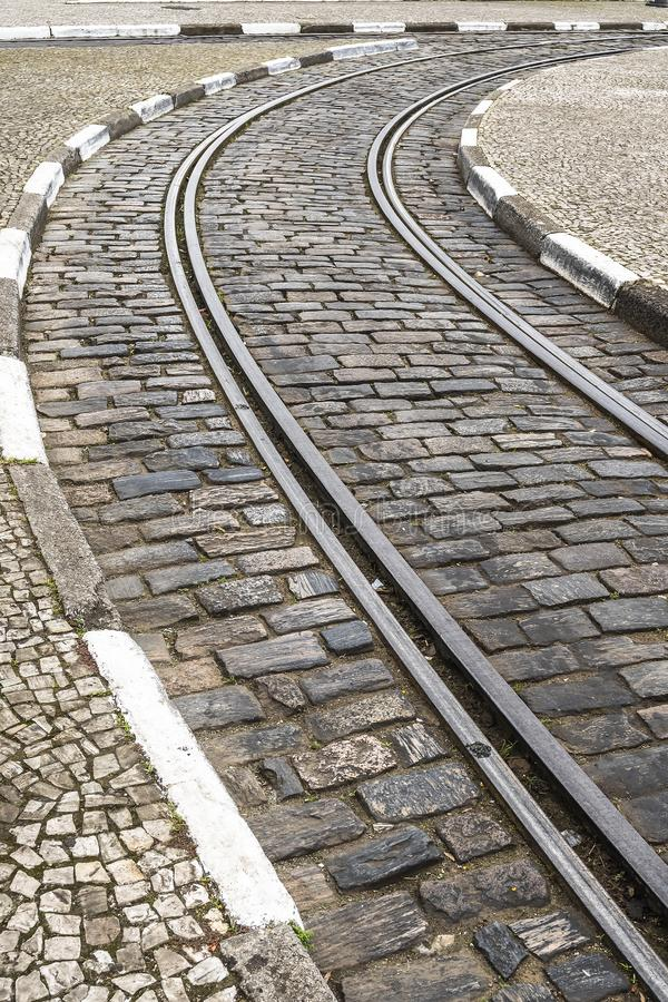 Tram rail on a old street. Tram rail on a street made of rectangular rock pieces of an old city. Street of Santos SP Brazil stock photo