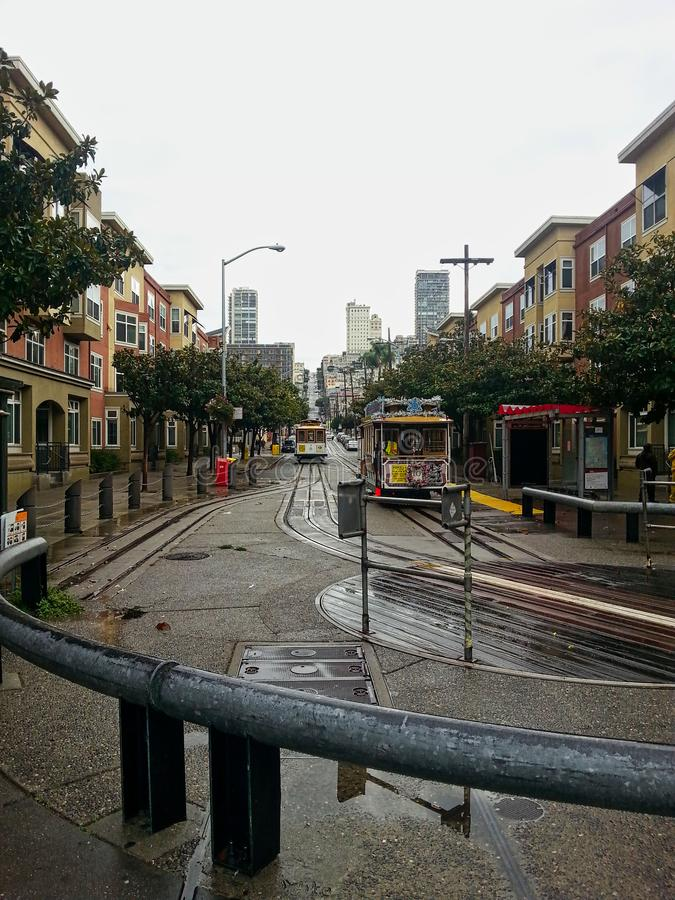 The tram in san francisco. Wet day california usa city travel transportation street america view landmark car cable vintage hill streetcar urban architecture royalty free stock image