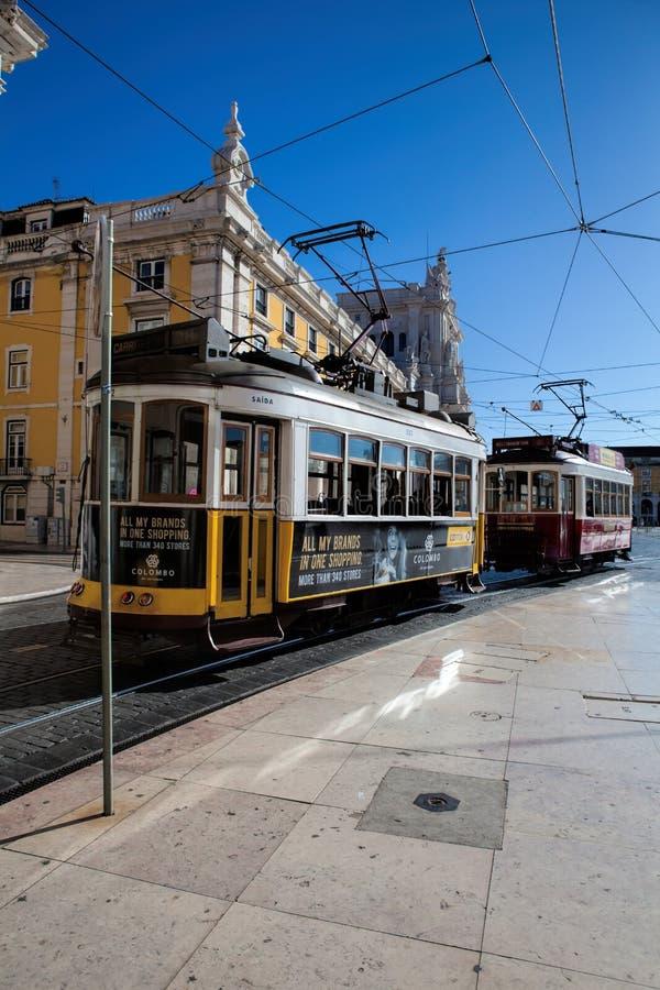 Tram on a square Praca de Comercio in Lisbon stock images