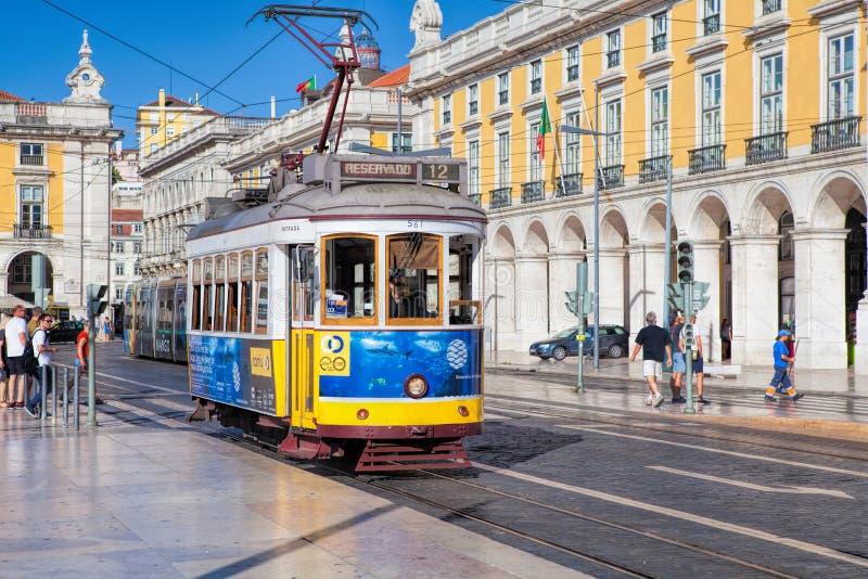 Tram on a square Praca de Comercio in Lisbon stock photography