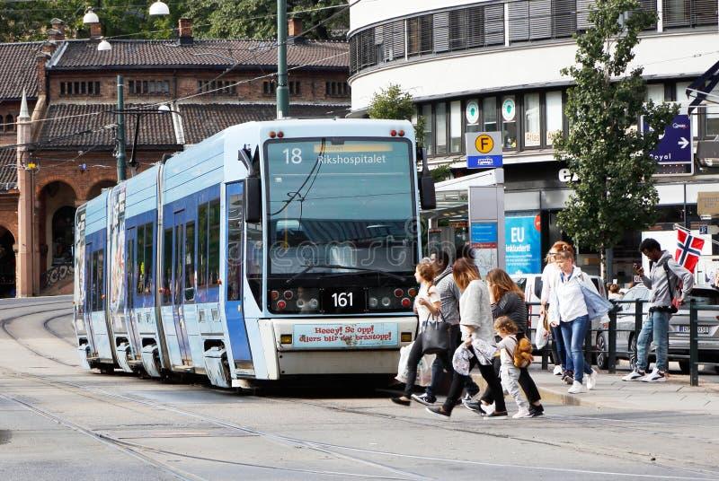 Tram at stop stock photos