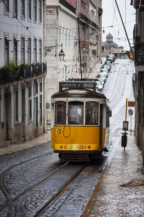 The 28 tram in a street of the Chiado neighborhood in the city of Lisbon, Portugal stock photography