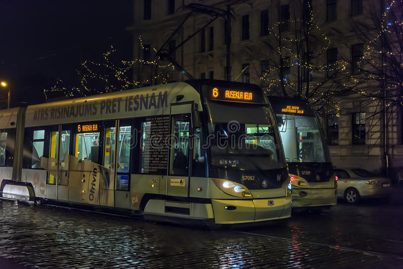 Tram at winter street of Riga town stock photography