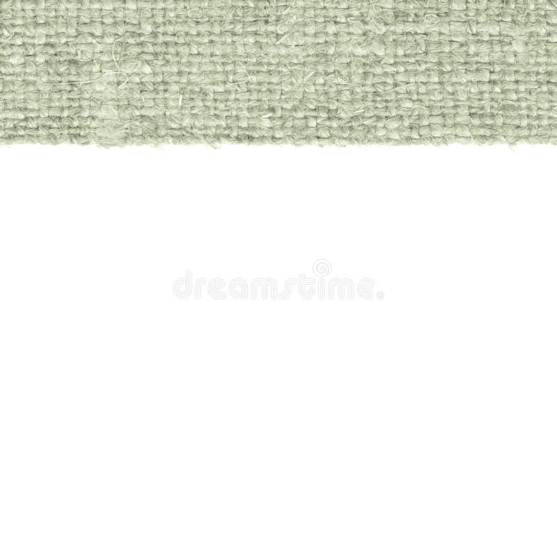 Trama de la materia textil, conceptos de la tela, lona de la malaquita, material de la harpillera, fondo en blanco imagen de archivo