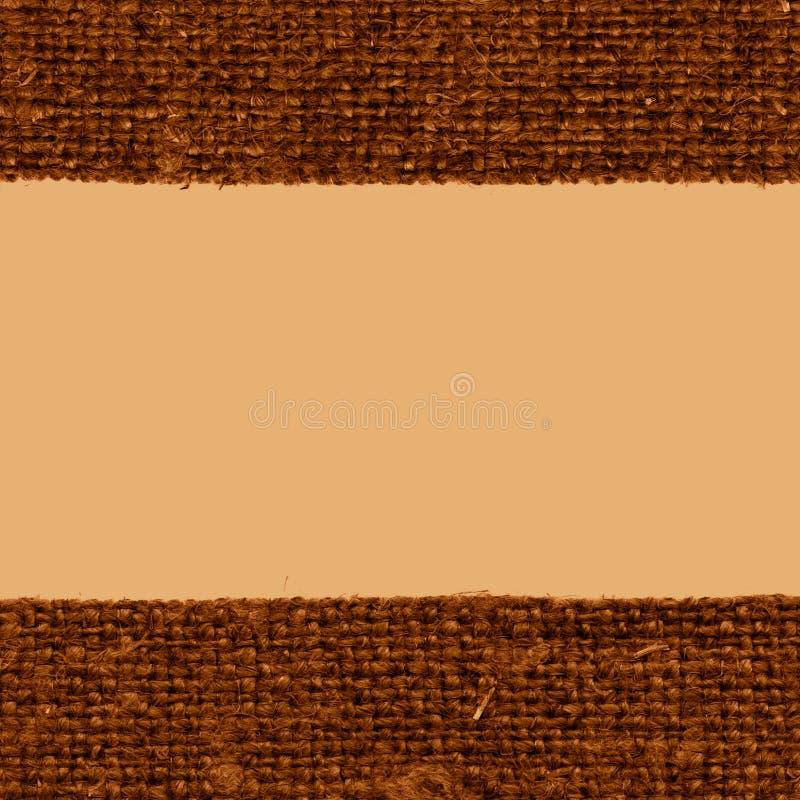 Trama de la materia textil, estilo de la tela, lona de color caqui, material del jutesack, fondo del primer imagen de archivo libre de regalías