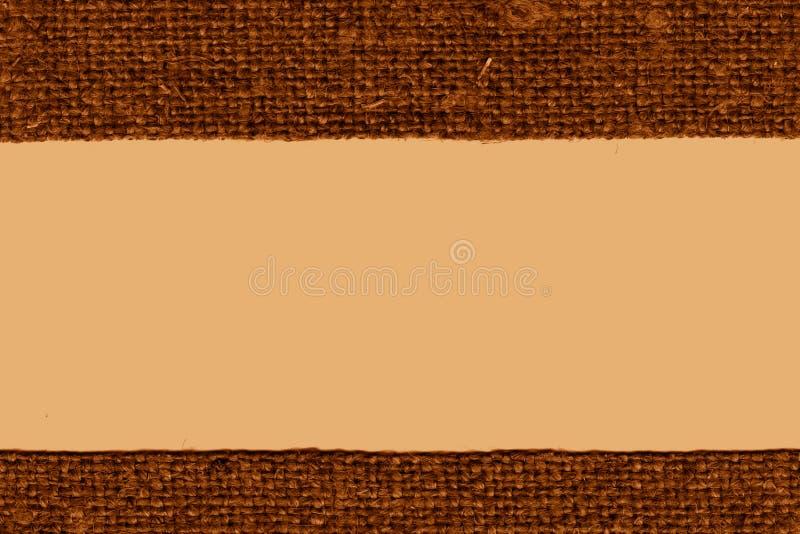 Trama de la materia textil, productos de la tela, lona ocre, material del cáñamo, fondo del arte fotografía de archivo