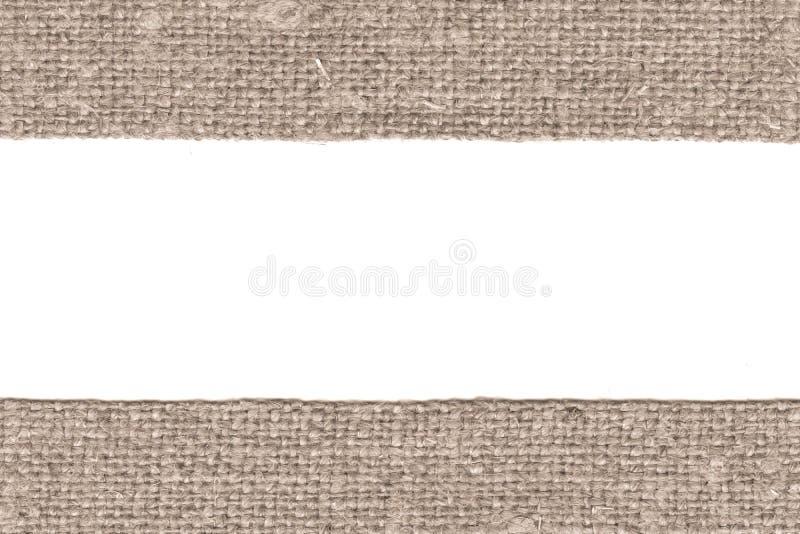 Trama de la materia textil, remiendo de la tela, lona marrón, material antiguo, fondo retro-diseñado imagen de archivo