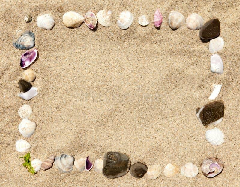 Trame d'interpréteurs de commandes interactifs et de pierres de mer image libre de droits