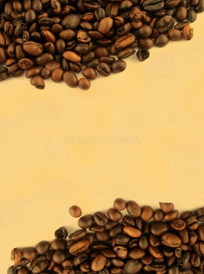 Trame de café contre le papier jauni image libre de droits