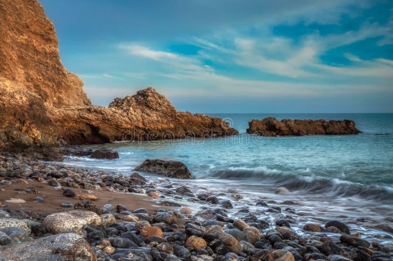 Tramonto alla spiaggia di Terranea fotografia stock libera da diritti