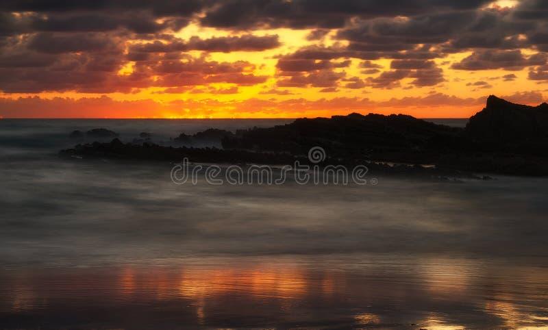 Tramonto arancione fotografie stock