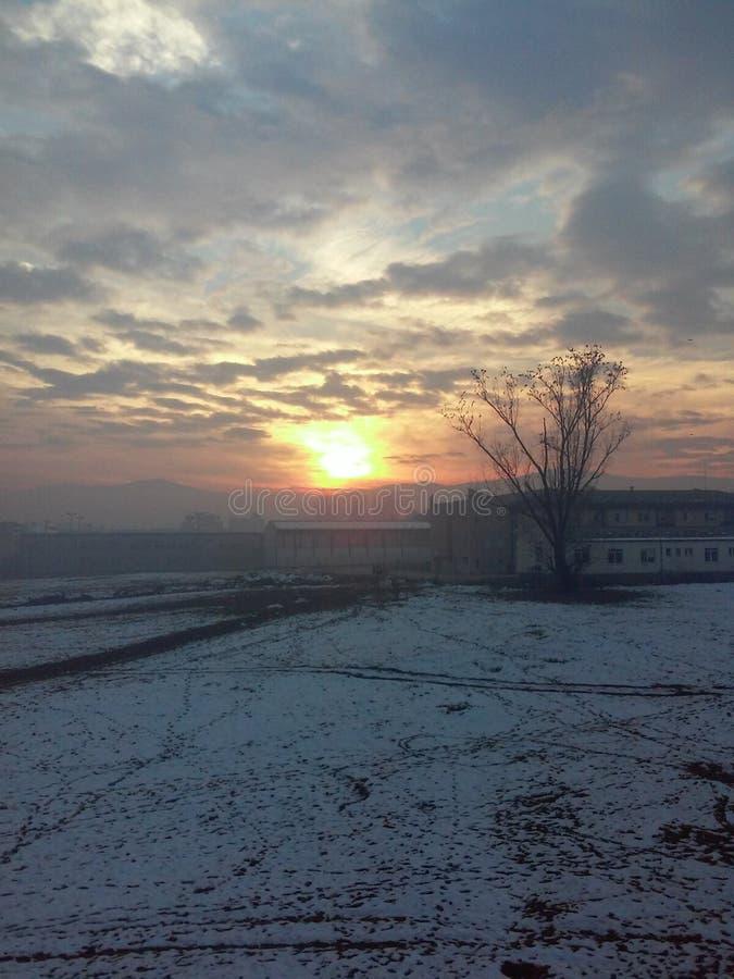Tramonto CONTRO l'aeroplano Inverno immagine stock libera da diritti
