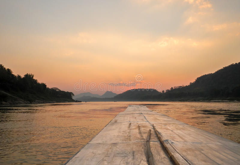 Tramonto del Laos sul Mekong fotografia stock