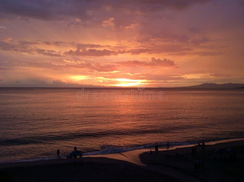 Tramonto dell'arancia della spiaggia fotografie stock
