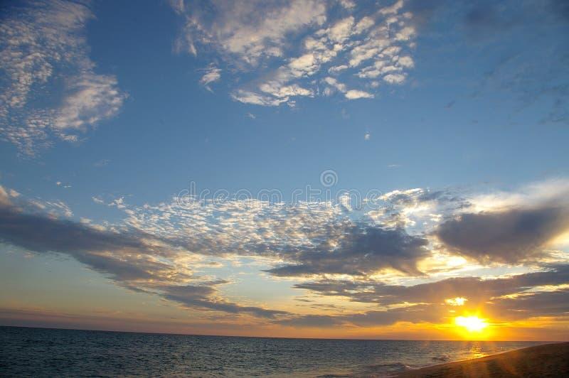 Tramonto della spiaggia fotografia stock