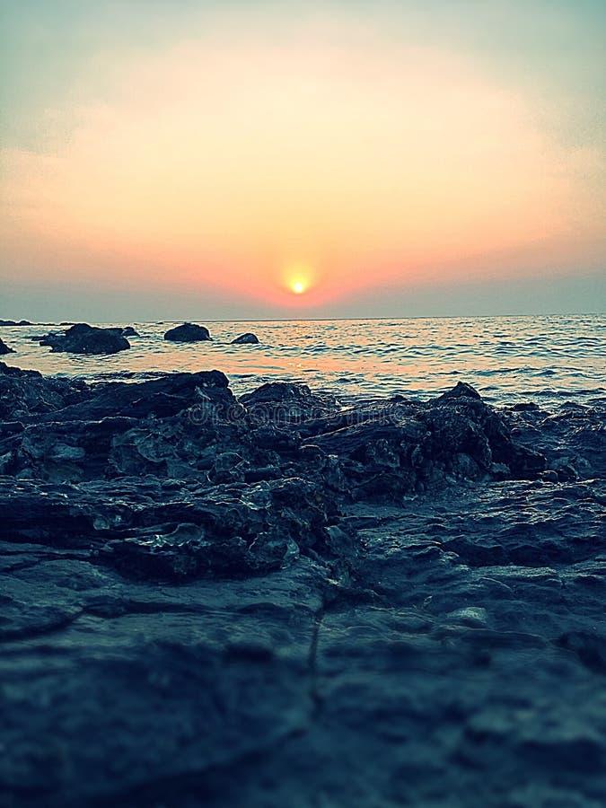 Tramonto di sera alla spiaggia fotografie stock libere da diritti