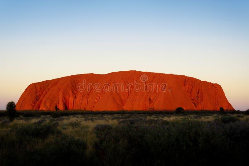 Tramonto di Uluru, entroterra Australia fotografia stock