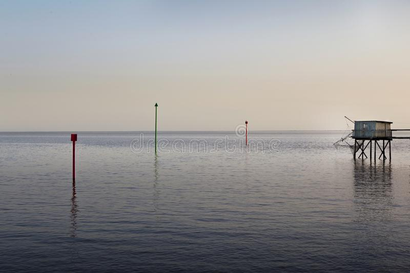 Tramonto e capanne da pesca fotografia stock libera da diritti