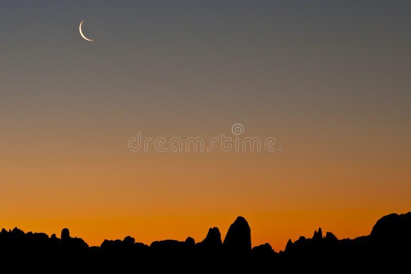 Tramonto e Crescent Moon fotografia stock libera da diritti