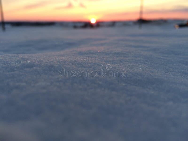 Tramonto nella neve immagini stock libere da diritti
