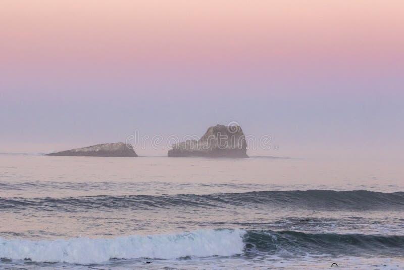 Tramonto & onde fotografie stock libere da diritti