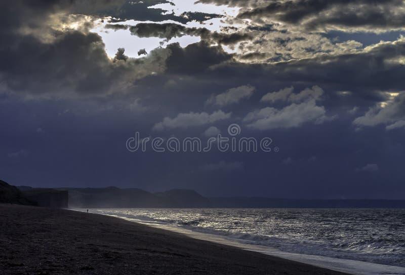 Tramonto su Devon Jurassic Coast immagine stock libera da diritti