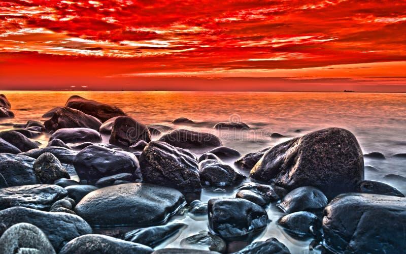 Tramonto sul litorale immagini stock libere da diritti