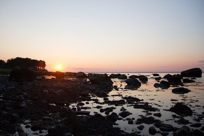 Tramonto verde della spiaggia dei Fiddlers immagini stock libere da diritti