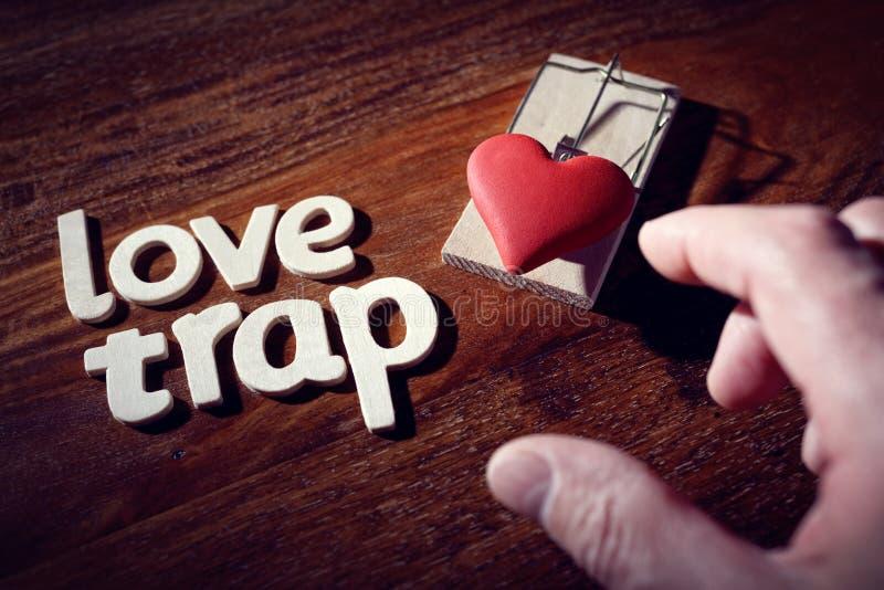 Trampa del amor imagenes de archivo