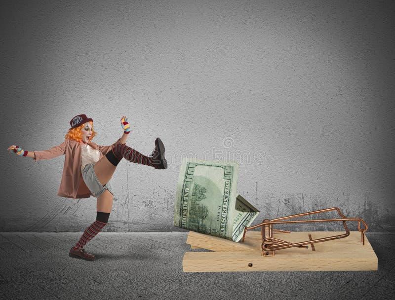 Trampa del dinero del payaso fotografía de archivo