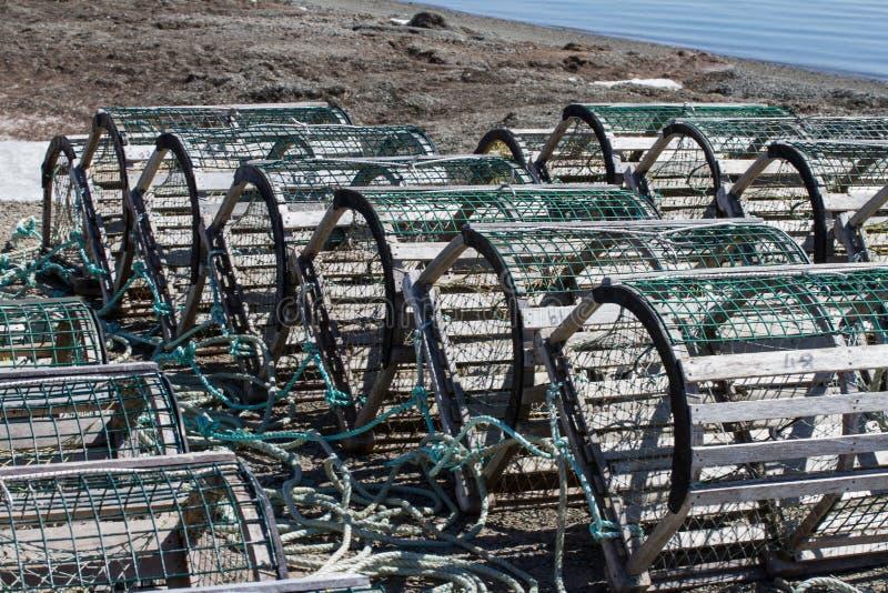 Trampas de la langosta/del cangrejo en la playa foto de archivo libre de regalías