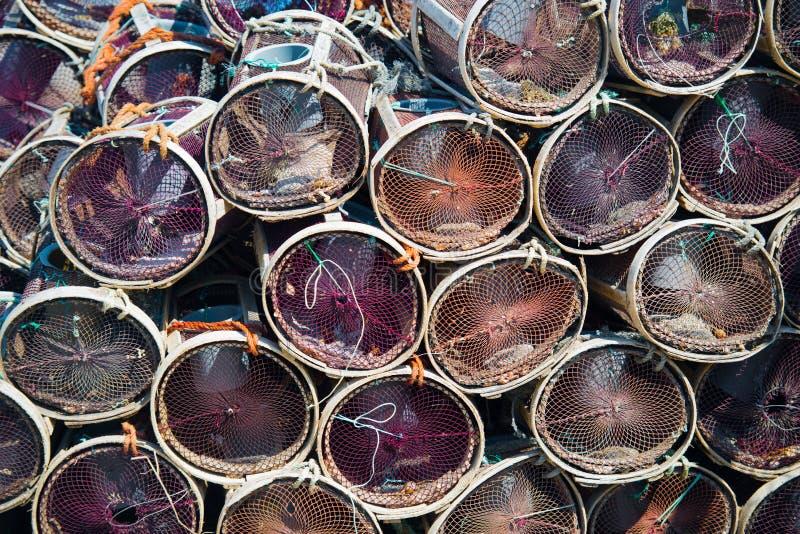 Trampas del cangrejo o de la langosta en un fondo náutico fotos de archivo libres de regalías