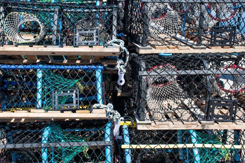 Trampas del cangrejo y de la langosta en una pila imagen de archivo libre de regalías