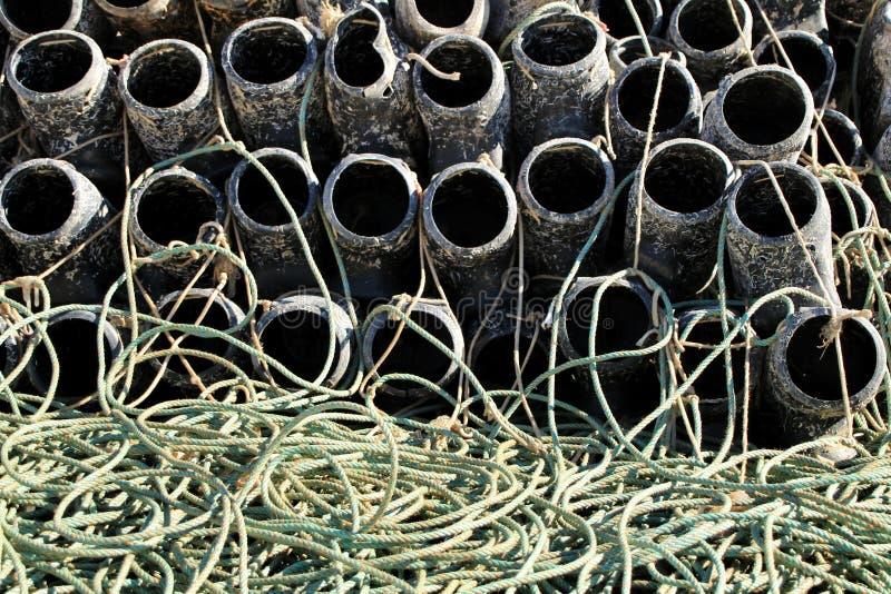 Trampas para pescar el pulpo y redes en el embarcadero de Santa Pola imágenes de archivo libres de regalías