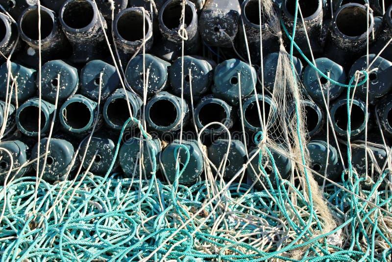 Trampas para pescar el pulpo y redes en el embarcadero de Santa Pola foto de archivo libre de regalías
