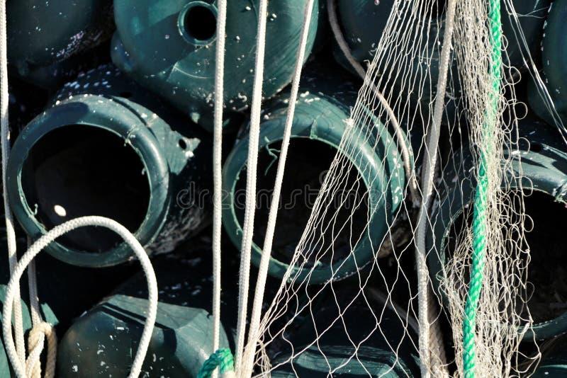 Trampas para pescar el pulpo y redes en el embarcadero de Santa Pola imagen de archivo libre de regalías