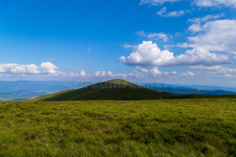 Trampled path through the top of the mountain against the background of sky blue in the Carpathians stock photography