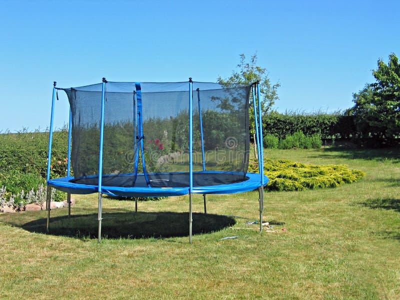 Trampoline in a garden. Trampoline in a back yard garden royalty free stock photos