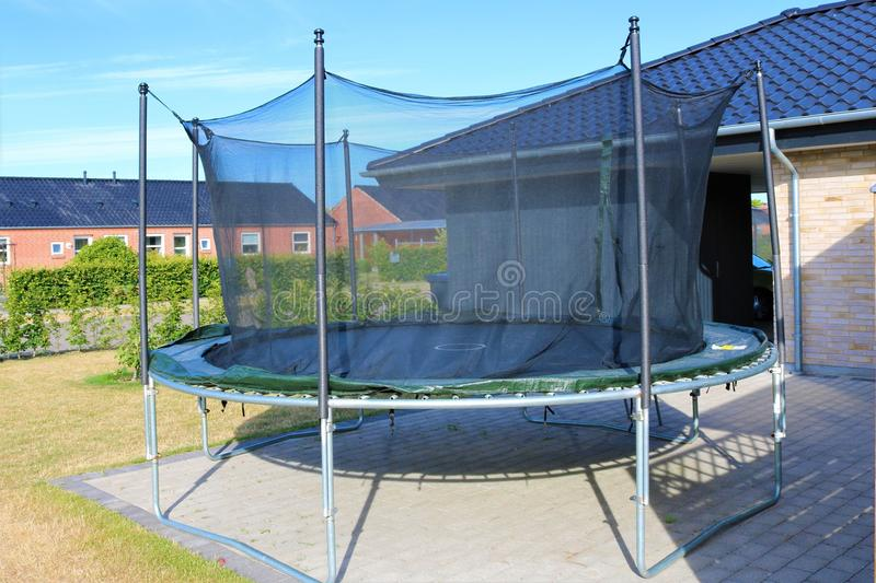 Trampoline. Jumping trampoline. Outdoor trampoline with safety net. royalty free stock images