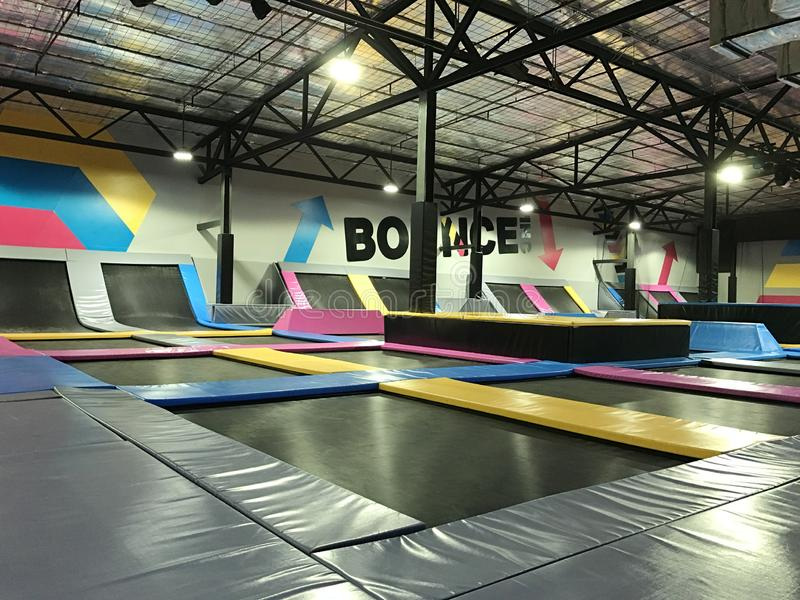 Trampolines indoor jumping. Next generation bounce playground and fun activity for all ages. Trampolines indoor jumping sport. Next generation bounce playground royalty free stock image
