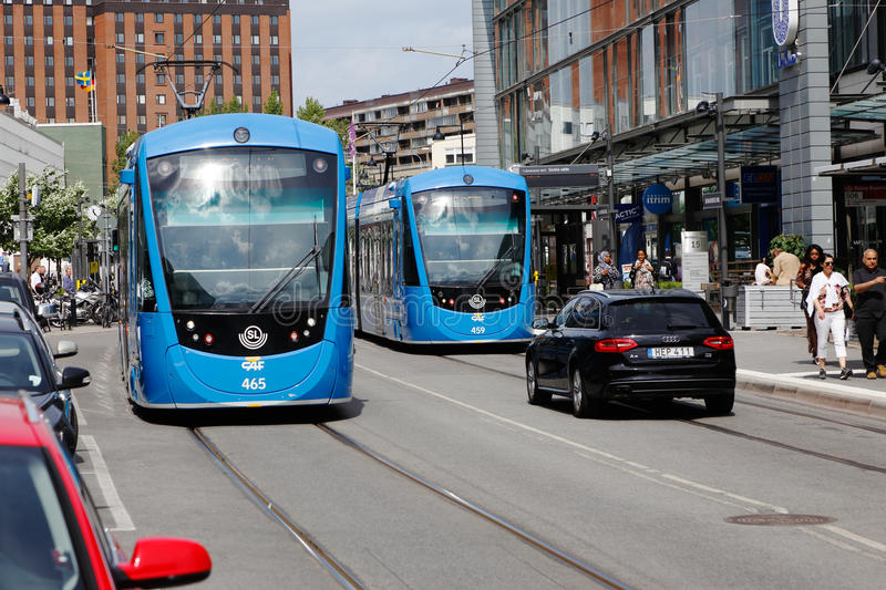 Trams in Solna business park. Solna, Sweden - June 15, 2016: Two trams in traffic for the Stockholm public transport at the tram stop on the tramway Tvarbanan stock photo