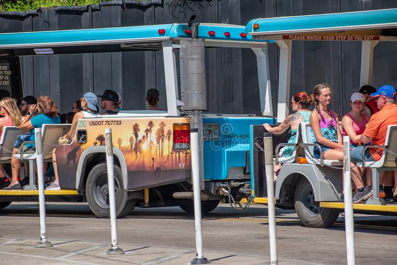 Trams used to transport visitors between the parking lot and the entrance at Busch Gardens 2. Tampa Bay , Florida. July 12, 2019 Trams used to transport visitors stock photography