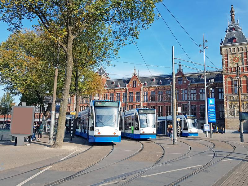 Trams waiting at Central Station in Amsterdam the Netherlands stock images
