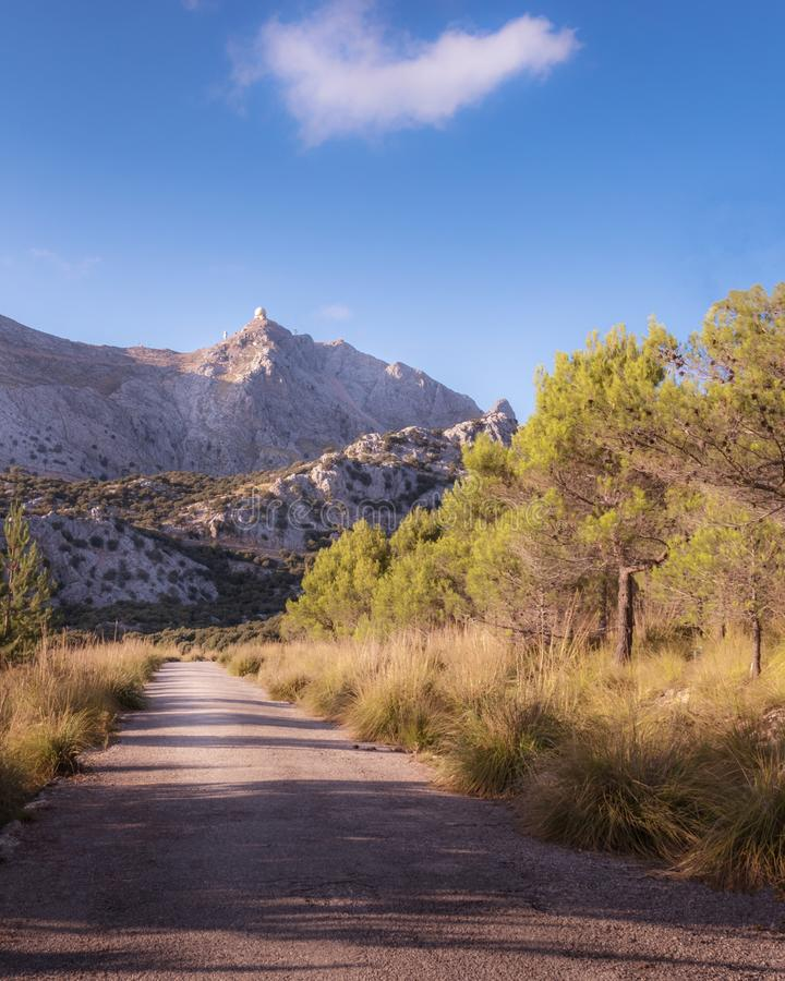 Tramuntana mountains on a sunny day with blue skies, lake reservoir, trees, trails and wildlife, Mallorca, Spain. Tramuntana mountains on a sunny day with blue royalty free stock photos