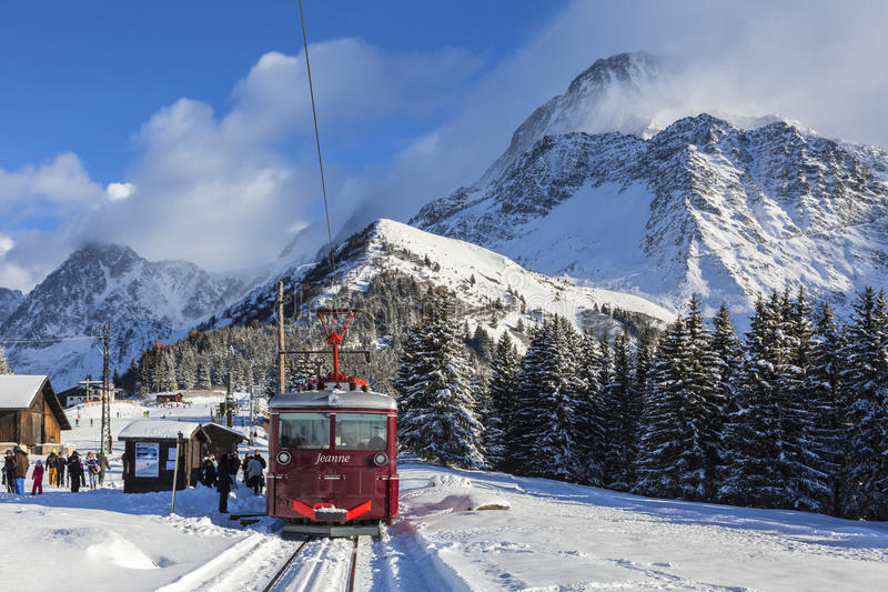 Tramway du Mont Blanc. Col de Voza, France - December 30,2014: TheTramway du Mont Blanc reaches the railway station on Col de Voza on 30 December 2014. This is royalty free stock photos