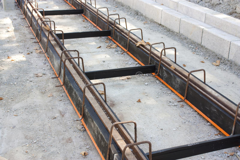 Tramway tracks with damping material coating. Construction of tramway track with steel rails coating - vibration damping material for noise reduction, in the royalty free stock images
