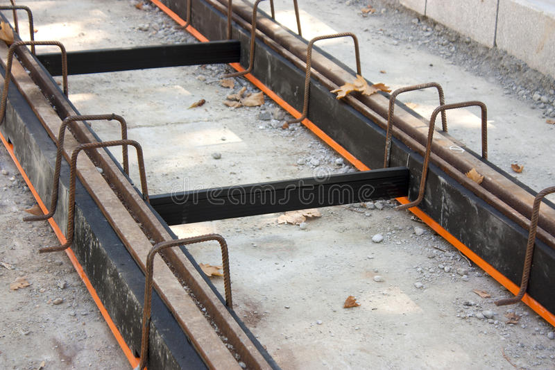 Tramway tracks with damping material coating. Construction of tramway track with steel rails coating - vibration damping material for noise reduction, in the stock image