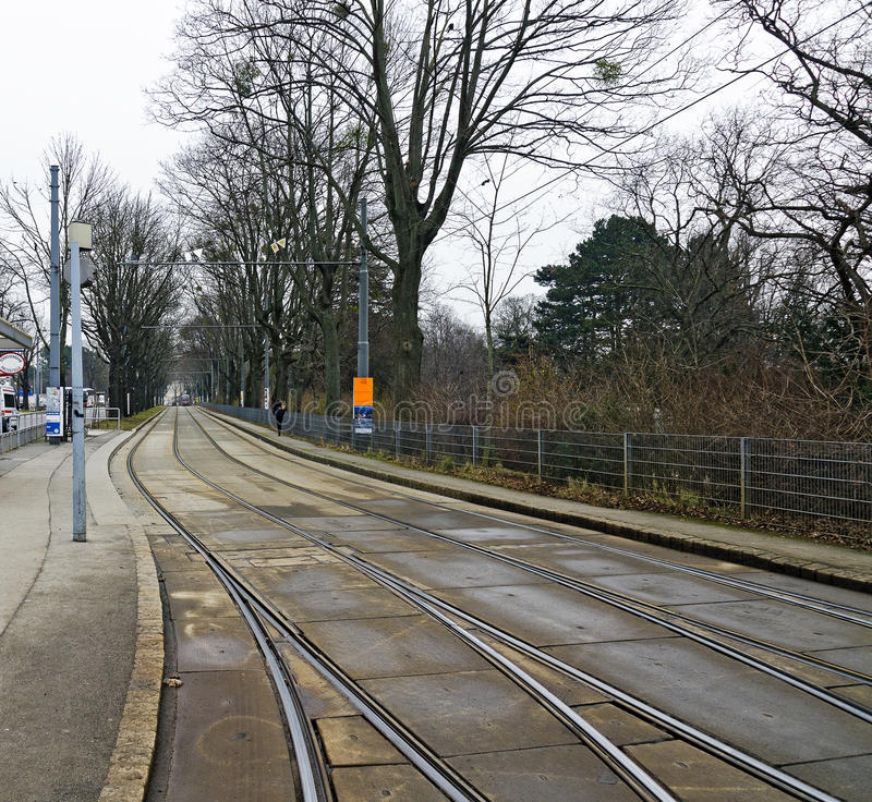 Tramway tracks with switches at separate lane. Alley with tramway tracks and switches at separate lane, Vienna, Austria stock image