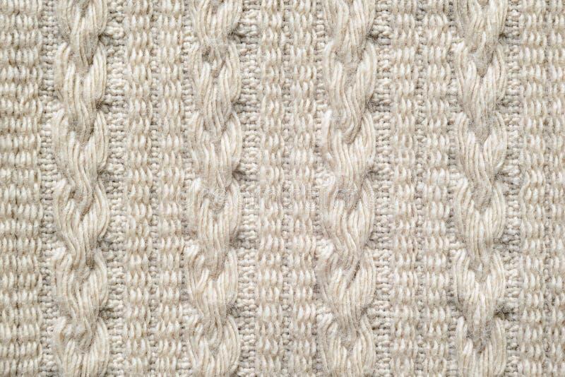 Tranças na textura bege da tela da malhas foto de stock