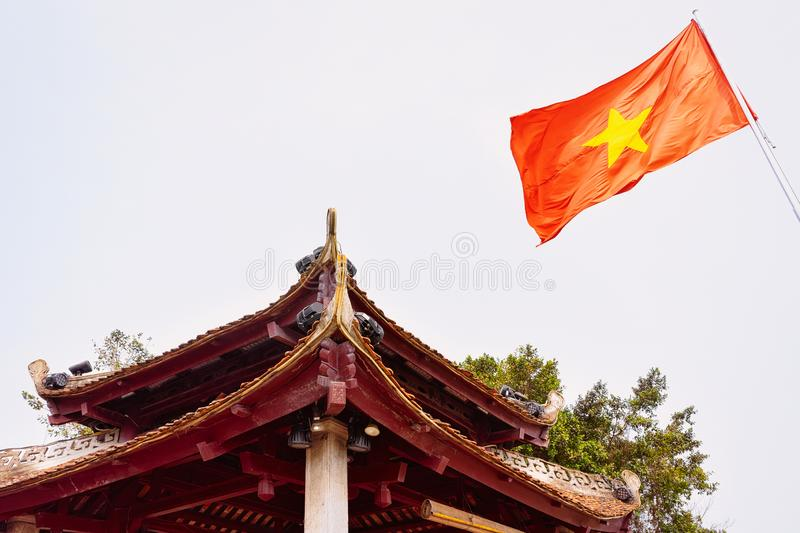 Tran Quoc pagoda and vietnamese flag in Hanoi stock images